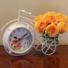 A beautiful table clock of 11x9 inches and flower bunch combo for your beloved.