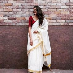 The ivory Kerala saree.