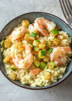 """Creamy risotto with shrimp, zucchini, and parmesan cheese. 