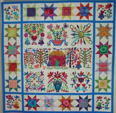 """""""Sueville Album"""" by Nedra Weaver.  Made with Kaffe Fassett Fabrics.  Posted at Glorious Applique. Sueville is a combination of parts of Kim McClean's 'Roseville Album' and 'Stars and Sprigs' patterns."""