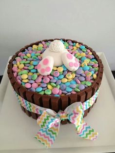 like the bunny idea. thinking carrot cake...crushed walnuts around the edge, with walnuts and 'dug up' mini eggs?