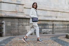 Nina Schwichtenberg wearing Escada pants, Proenza Shouler bag, Stella McCartney shoes seen outside during Milan Fashion Week Fall/Winter 2016/17 on February 25, 2016, in Milan, Italy