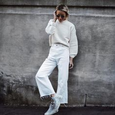 A ribbed knit with cropped wide-leg jeans and high-top sneakers. A ribbed knit with cropped wide-leg jeans and high-top sneakers. Cropped Jeans Outfit, White Jeans Outfit, White Culottes Outfit, White Jeans Winter, White Denim, Winter White, Wide Jeans, Cropped Wide Leg Jeans, High Street Fashion