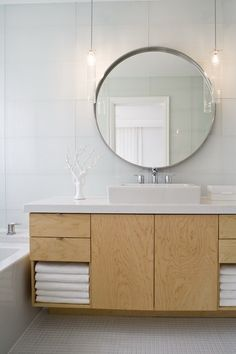 Master bath Dilemma: Lighting & Mirror + one sink & mirror or two? Copyright © Toronto Interior Design Group