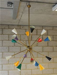 I'm in love with this large, colourful Italian 'Stilnovo' mid-century chandelier with metal shades on a brass frame. I think it would work really well in a modern open-plan living kitchen. Mid Century Modern Chandelier, Mid Century Lighting, Contemporary Chandelier, Mid Century Decor, Mid Century House, Mid Century Furniture, Art Deco Chandelier, Chandelier In Living Room, Bedroom Chandeliers