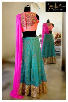 Teal / turquoise / greenish blue pink coral peach lehenga. Love the colour combination!