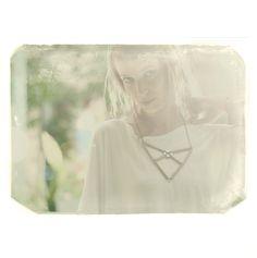 the origami arrow necklace. $50.00, via Etsy.