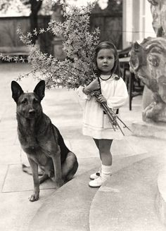Helga Goebbels and Adolf Hitlers' dog. The dog was used to test the cyanide capsules they took. The poor little girl was killed by her own parents in the Berlin bunker as the Nazi empire crumbled.  Unfortunate child: alas, one cannot choose their parents.
