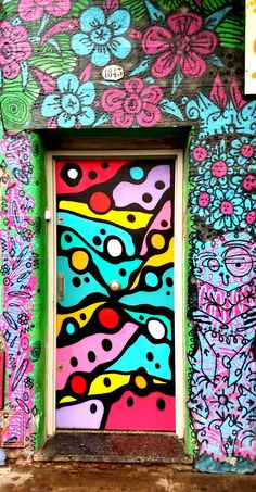 Buenos Aires, Argentina - Street Art & Graffiti (Doors) – This is from the cool art district, Palermo Hollywood.. Although the street art and graffiti is not as abundant as say what I have seen in Brasil, it is still beautiful. What is more unique to Buenos Aires is the number of stores with colored facades or street art decorated store fronts. Original Photography by R. Stowe.