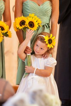 The cutest flower girl with blooming sunflowers! | Cariad Photography | See More: http://heyweddinglady.com/spring-green-southern-wedding-wi...