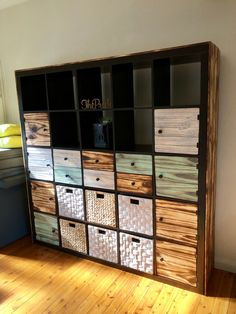 My Ikea Kallax shelving hack Kallax hack with Shou Sugi Ban style pine doors, drawers & cladding Ikea Kallax Shelving, Kallax Hack, Pallet Furniture, Furniture Ideas, Pine Doors, Cladding, Drawers, Hacks, Shelves