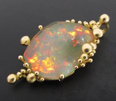 Briolet Studio, gold pendant with Welo opal