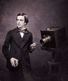 "Walter Bentley Woodbury, age 23. Self-portrait with a camera, 1857. This British-born photographer sailed to Austraila when he was twenty and ran a sucessful photography studio first in Melbourne, and then in Java, Indonesia.   He enclosed this photograph with a letter to his mother:   ""The portrait I send has the date marked on it and in the future I shall always date them so that you can see if I improve in appearance or otherwise."""