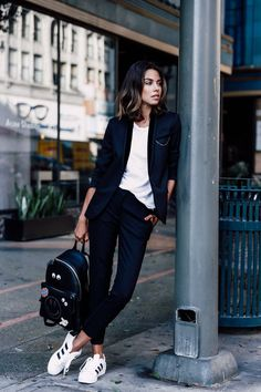 sneakers with tuxedo blazer and backpack