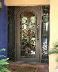 not this exactly, but the iron works cover full length side lights and door, large pull on storm with deadbolt? is there room for this? black front door can have full glass House Front Door, Windows And Doors, House Doors, Entrance Doors, Beautiful Doors, Door Entryway, Iron Front Door, Iron Entry Doors, Doors