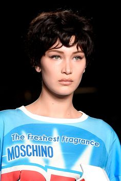 Choppy bowl-cut wigs, in various colours, were sported at Moschino which some speculate were inspired by 90s-era supermodel Linda Evangelista. Makes sense to us. The makeup features feline flicks of liquid liner and a soft brown lip. Throwback!   - Cosmopolitan.co.uk