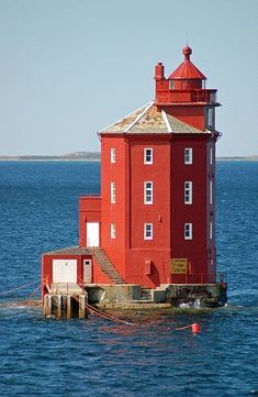 Kjeungskjaer Lighthouse is located on a tiny island at the mouth of the Bjugnfjorden west of the village of Uthaug, Norway.
