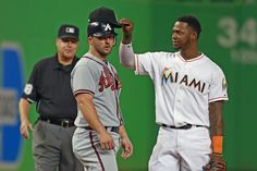 Hanley Ramirez tries to make Dan Uggla a Marlin again. Credit: @kellyspics on Twitter