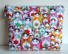 Large toiletry bag or cosmetic make up bag in rare russian doll fabric. $28.00, via Etsy.