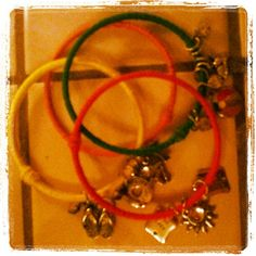 Wrapped bangles with friendship bracelet string (cheap at Walmart) and attached charms ($4.99/pack from Michael's)