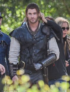 Because he's worth it: Chris Hemsworth had a helping hand with his lovely long fake locks on the Surrey set of The Huntsman on Thursday