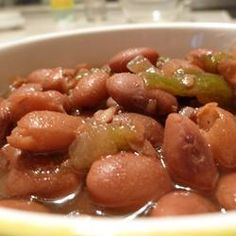 Slow Cooker Pinto Beans - very good! Used small mason jar of homemade chicken stock with fat on top and box of chicken broth and omitted the lard, 1 lbs dried pinto beans. Added garlic salt and omitted celery. Used Boars Head deli ham. Crockpot Dishes, Crock Pot Slow Cooker, Crock Pot Cooking, Slow Cooker Recipes, Crockpot Recipes, Cooking Recipes, Healthy Recipes, Healthy Food, Pinto Bean Recipes