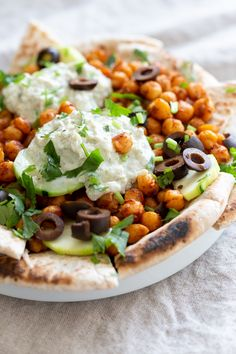 Vegan Mediterranean Nachos with Shawarma Chickpeas, Tzatziki, Olives, Cucumber, warm toasted Pita bread. Great Appetizer for parties or potluck. Healthy Appetizers, Appetizers For Party, Appetizer Recipes, Pita Bread Nutrition, Nachos, Shawarma Spices, Vegan Tzatziki, Tzatziki Sauce, Delicious Vegan Recipes