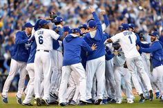 Oct 15, 2014; Kansas City, MO, USA; Kansas City Royals players celebrate on the field after defeating the Baltimore Orioles in game four of the 2014 ALCS playoff baseball game at Kauffman Stadium. The Royals swept the Orioles to advance to the World Series. (Peter G. Aiken-USA TODAY Sports)