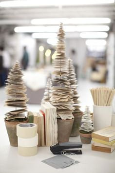 "Trees with book pages this reminds me of the old spindles they used on their desks to ""hold"" papers. Showing my advanced age."