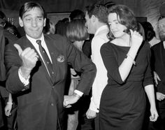 "Frank ""Killer Joe"" Piro, expert of discotheque dances, shows his partner, Kathleen Carroll, how to do the hitch-hiker. Piro was a dance instructor who popularized disco dancing in the 60s and 70s."