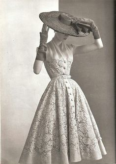"Photo found on: http://the50shousewife.com/2014/10/dress-for-marriage-success-play-up-your-feminine-nature/ This is a typical 1950s dress.1950s style included feminine and romantic silhouettes - full circle skirts, fitted pencil skirts and A-line shapes - that marked women's return to home and hearth after the war years.Dior and Balenciaga are the most successful designers in this decade. And all of the beautiful changes from Dior ""New look"" 1947"