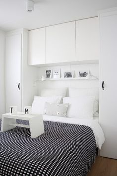 Tall, shallow cabinets/shelving on either side of the bed, together with upper cabinets to bridge across, make the bed feel cozy and built-in AND amp up the storage space--perfect for extra pillows/linens, books, seasonal clothes, & closet overflow.