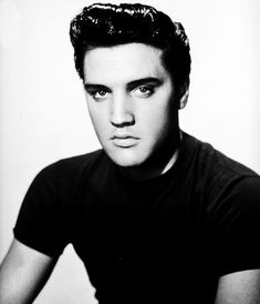 This has to be a photoshop job!  Elvis' head image is much too big for the tiny body in the t-shirt.  Not really Elvis' style for clothes, either.