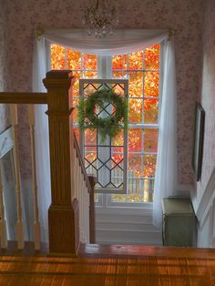 wreath in front of window----ABSOLUTELY MAGNIFICENT!!