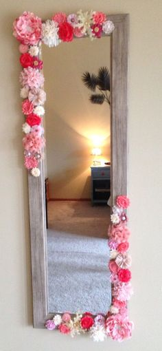 Add fabric flowers to any mirror (this one $35 at Menards) for a fun and feminine look! Do not skimp on flowers (there are 50 on this one), and make sure you have a variety of shades and fabrics.: