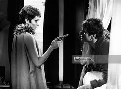 Spanish actress Nieves Navarro aiming a gun at Italian actor Giuliano Gemma's face in Kiss Kiss - Bang Bang. London, 1966