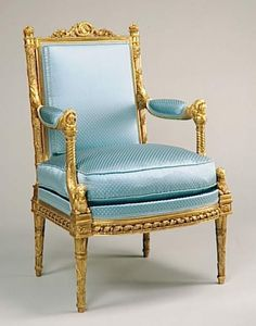 Marie Antoinette Arm chair by George Jacob in her Meridian at Versailles carved with one of her favorite dogs at the top of the arm and a Sphinx at the bottom ca. 1785.