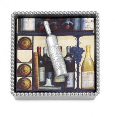 If she loves wine, a delightful cocktail napkin holder with wine bottle weight:  $48.00