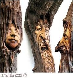 """close up of the 3 faces from   """"Tranquility of Trees""""   This serene scene of tree spirits measures about 30  inches tall and right around 4 inches across its widest.  The piece of driftwood I used here is packed full of resin  and is quite solid. Time and Nature has left this stick with  some beautifully textured grain throughout.     Signed and dated:  N. Tuttle 11/15/13"""