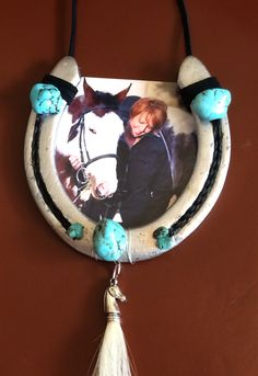 Horse memento with the horses old shoe, braided tail hair inset in the shoe, turquoise, while tail hair tassel (paint horse with black/white tail), suede hanger and favorite photo. Great Christmas present/ornament!