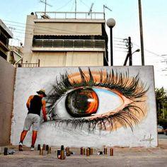 Realistic eye street art by Simple G