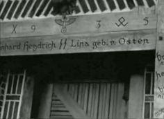 The words read Reinhard Heydrich and Lina von Osten, which are over the front door of the Heydrichs' home