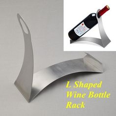 Simple and Elegant Letter L Shaped Art Stainless Steel Wine Bottle Rack Holder by Neewer. $7.58. To place the wine bottle on; Durable and easy to clean. Great gift and best choice for wine lovers; Give your home wine a perfect home.. Generic Letter L Shaped Art Stainless Steel Wine Bottle Rack Holder Silver. Material: Stainless steel; Weight: 11.80 Ounce; Size: 24x10x22cm; Color: Silver. L Shaped champagne wine bottle holder; Simple and elegant design. Package contents:  * 1...