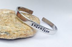 """""""If you follow the inner path using truth and clarity as your compass points, the outer world cannot help but respond to your intention"""" Deepak Chopra Intention Cuff Bracelet by BlissfulBirdDesigns on Etsy, $17.95"""