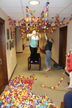 It takes a village to hang up the chains so enlist lots of people to assist. It is fun. Tall people also come in handy!!! cokesburyvbs.com