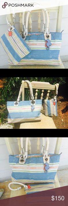 F16624 Coach Nautical Beach Rope Purse Wallet This is a gorgeous set for the summer or beach.  This set is no longer sold in stores & the bag can be found occasionally, but the wristlet included is very hard to find.  Both pieces are in excellent condition and A-D-O-R-A-B-L-E!   The details with the seahorse and colors are very pretty.  The bag does zip!  Both pieces have thick nautical rope for handles.  Smoke and Pet Free Home.  I teach and cleaning out for the summer, so please check out…
