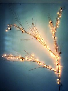 Decorate your bedroom with a tree branch covered in Christmas lights! Add ornaments to personal taste.
