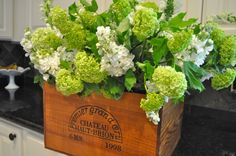 flower arrangement - add jars inside of boxes for water sources, and for arranging