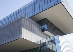 Glass boxes cantilever from the concrete core of Tatiana Bilbao's Bioinnova university building.