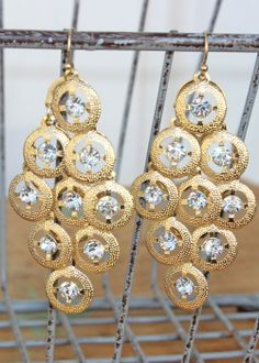 """A good chandelier earring is always in style, but when you add the crystal and gold combo you get a look that is out of this world. Hook earrings. Measures 2.5"""" in length including hook and 1.25"""" in width. $28.00"""